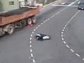 MotorcyclistSquashedByAllFourTruckTires