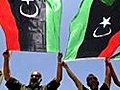 LibyanscelebrateKadhafiarrestwarrant