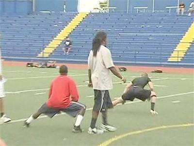 NFLPlayerTeachesYouthFootballCamp